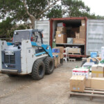 20ft container being packed with boxes of tools & equipment - 2007